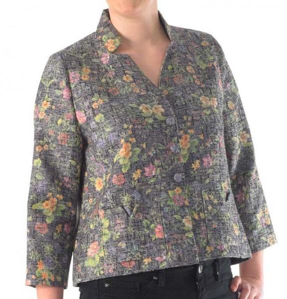 Kurze Jacke mit eckigen aufgesetzten Taschen aus einem grauen Leinen mit Blumen.